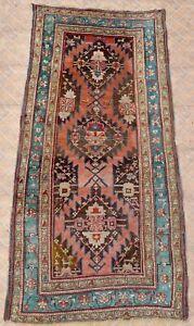 An Antique Susha Karabagh rug, dated 1899
