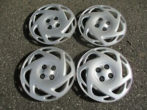 Factory 1994 to 2002 Saturn S series bolt on 15 inch hubcaps wheel covers