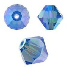 Genuine Swarovski Bicone. Sapphire AB Color. 4mm. Approx. 144 PCS. 5328