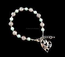 Antiqued silver heart and flower bead bracelet
