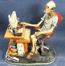 Skeleton at the Computer Desk with Headphones Figurine