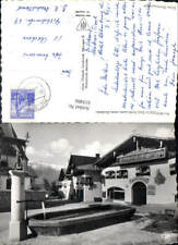 610466,Foto Ak Mutters Tirol Dorfbrunnen geg. Nordkette Brunnen