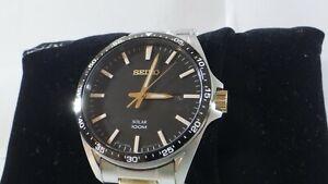 Seiko Men's SNE485 Solar Two Tone Black Dial Stainless Steel Watch