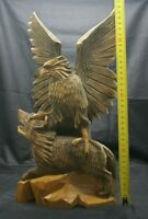 Wooden sculpture of an eagle with a Wolf