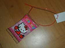 Sanrio Hello kitty apple plastic puffed trinket cellphone accent   1 by 2 inches