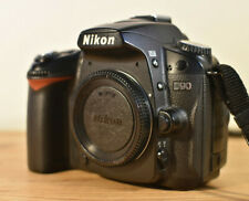 NIKON D90 DSLR CAMERA BODY WITH CHARGER, BATTERIES, MANUAL & STRAP