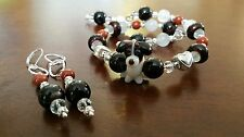 Handcrafted beautiful black, white and tan dog themed bracelet and earrings set