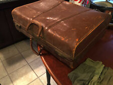 A bundle of vintage leather suitcase, military socks and ties