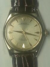 Rolex Oyster Perpetual mid size 14 k solid gold  6548