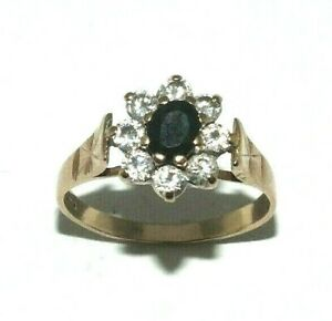 Ladies/womens 9ct yellow gold ring set with a sapphire and CZ stones, UK size K