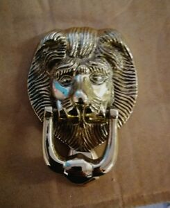 brass lions head door knocker.