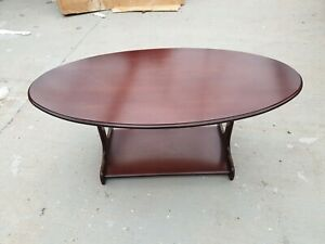 Traditional Dark Wood Oval Coffee Table with Low shelf