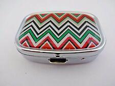 Pill box silver metal chevron zig zag design orange black white 2 compartments a