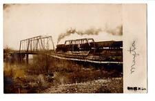 1907 RPPC real photo Train on trestle bridge Evart, Mi. Jamestown stamp #