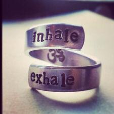 inhale exhale OM symbol  inside aluminum twist meditation , yoga reminder ring
