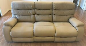 3 Seater lounge with 2 inbuilt recliners near new and under warranty