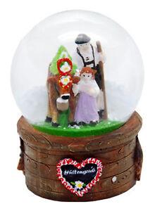 Souvenir Schneekugel Hüttengruß Almabtrieb