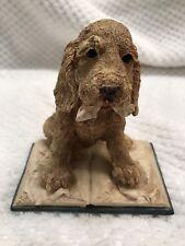 Vintage Goebel prints mischievous pup on book figurine
