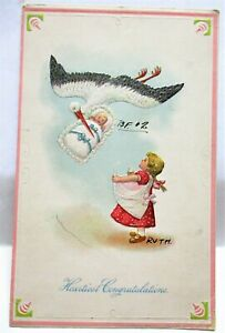 1910 POSTCARD HEARTIEST CONGRATULATIONS, STORK DELIVERING BABY TO GIRLS APRON