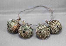 4 beaux grelots anciens à fente en croix type tyrolien en bronze ?