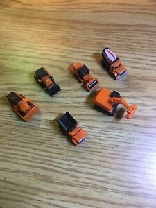 Six Micro Machines construction equipment, backhoe, loader, concrete mix etc