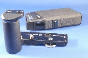 Olympus OM Motor Drive Control Grip 1 and Motor Drive 1 .