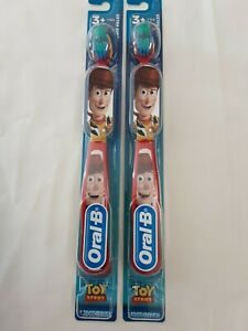 """Lot X2 Oral B Toy Story Red & Yellow """"Woody"""" Extra Soft Toothbrush Ages 3+ NEW!"""