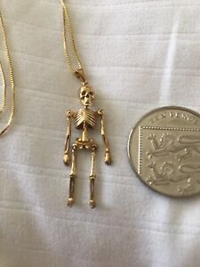 9ct Solid gold novelty moving articulated skeleton Pendant skull and bones charm