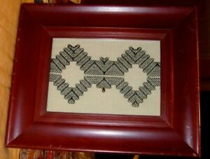 Embroidered southwestern style art, distressed red frame, black, ivory, .