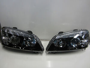 HOLDEN COMMODORE WM STATESMAN CAPRICE HEADLIGHT PAIR NEW LEFT AND RIGHT SIDE