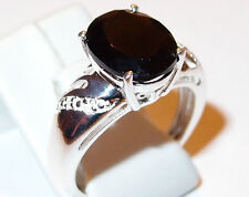 4.25ct oval Black Spinel and Diamond ring in Sterling Silver, Size O.