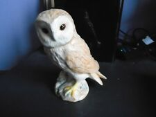 A BESWICK MODEL OF A BARN OWL IT STANDS 12CMS. TALL