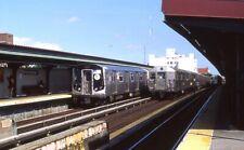 Nycta Kodak slide. New vs Old with a 3-way meet. R160 passes R32 subway trains