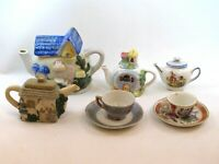 4 Miniature Teapots and 2 Cups & Saucers