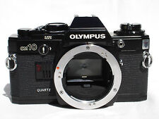 Olympus OM-10 Camera Body only  Quartz. Black. OM10  Works good!   SN1213009