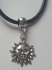 FLAMING SUN TIBETAN SILVER CHARM PENDANT ON BLACK LEATHER CHOKER NECKLACE.