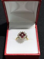 18 CT GOLD RUBY AND DIAMOND RING.
