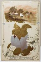 Easter Greetings Golden Chick & Eggs Lillies Sailboat Embossed 1910 Postcard E3