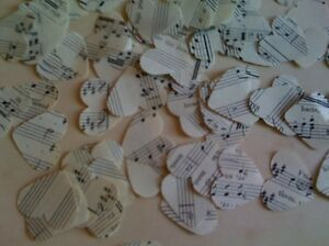 Heart shaped wedding table confetti made from vintage music manuscript genuine