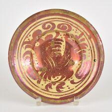 Plat Hispano-Mauresque en faience 17ème lustré reflets métalliques décor oiseau