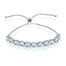 Oval-cut 7x5mm Blue Topaz Adjustable Tennis Bracelet in Sterling Silver