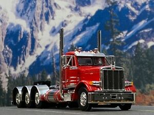 1/64 DCP RED PETERBILT 379 TRI AXLE DAY CAB