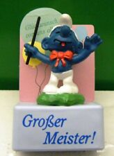 2.0061 GERMAN LANGUAGE BAND LEADER SMURF ON RECTANGULAR STAND – VERY GENT USED