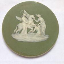 An antique Wedgewood Jasperware green ceramic roundel plaque - mythological