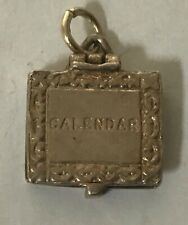 LOVELY RARE VINTAGE BRACELET CHARM OF AN OPENING NUVO CALENDAR 📅