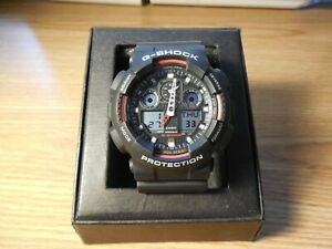 CASIO MEN'S GSHOCK GA100-1A4 Red & Black Analog Digital Watch