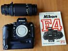NIKON F4 SLR S/N 2414175 with MB-23 and NIKON AF 75-300mm f4.5-5.6 + F4/F3 BOOK