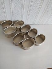 8 NAPKIN RINGS,IN SILVER PLATE. MODERN, ALL  SAME DESIGN AND IN NICE CONDITION.