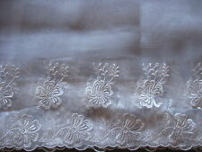 6 1/4 YDS SCALLOPED WHITE FLORAL RAYON EMBRDROIDERED ON POLY ORGANZA LACE.