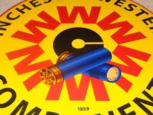 """VINTAGE 1959 WINCHESTER WESTERN COMPONENTS 12"""" PORCELAIN METAL GUN & BULLET SIGN"""